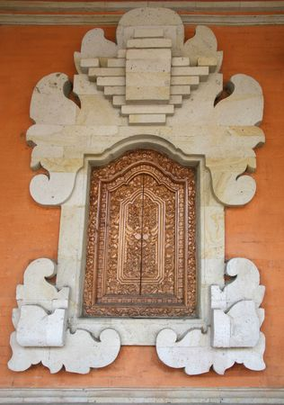 craft product: A photo of a window Wood Carving Door in bali Stock Photo