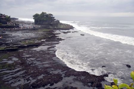 Photo shot of a gaint wave taken in Tanah Lot in Bali. photo