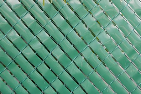 Background image of a chain link green fence. photo