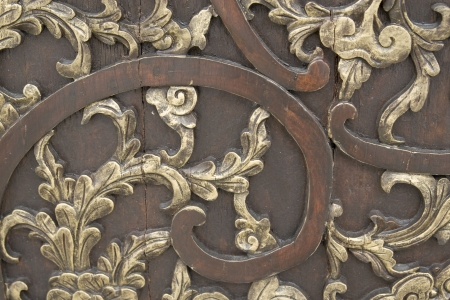 Old flora carving on ancient orient chinese door. photo