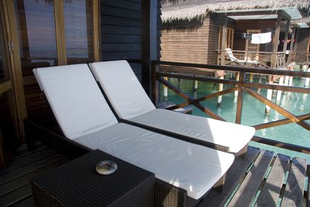 Two chairs on the balcony of a villa in maldives photo