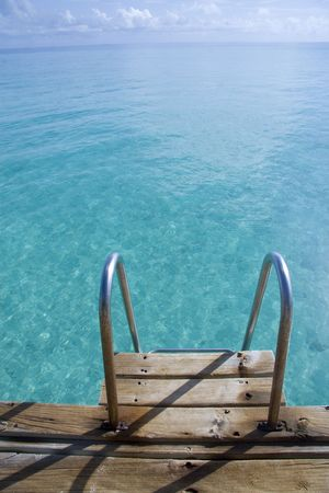 A ladder way into the open sea in maldives. photo