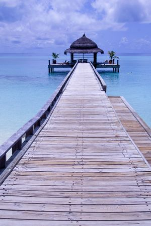 Long pathway to a watercafe facing the ocean in Maldives photo