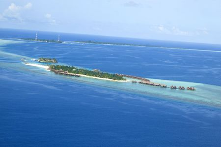 A top view of a island resort with villa in maldives photo