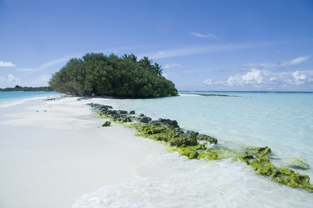 Beautiful maldives beach with clear transparent water and green rock Stock Photo - 8577885