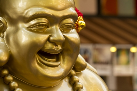 A close up shot of the chinese laughing buddha  photo