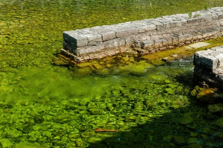 joins: Freshwater that appears green due to algae, joins the sea in Boka Kotorska Bay, Montenegro