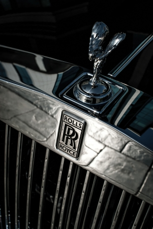 Front of the Rolls Royce car with logo and  The Spirit of Ecstasy  bonnet ornament, photographed in low-depth-of-field  Stock Photo - 21794892