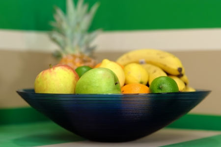 bannana: Decorative looking bowl with fresh fruits, low depth-of-field.