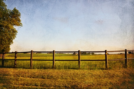 splotchy: Fence in rural country with a vintage look. Stock Photo