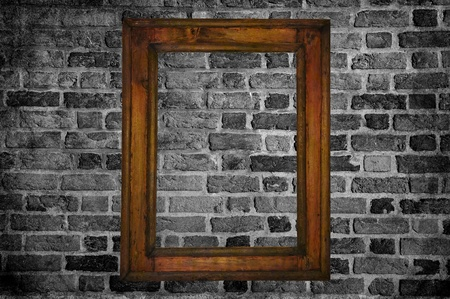 old wooden frame on brick wall. Stock Photo - 11621380
