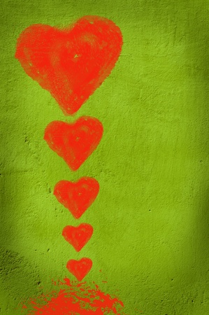 Red hearts on green background. photo