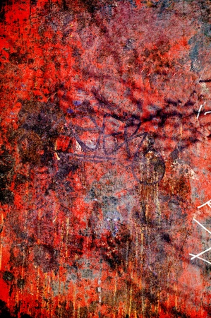 Textured rough graffiti background in red. photo