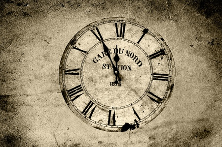 splotchy: An old station clock in sepia grunge.