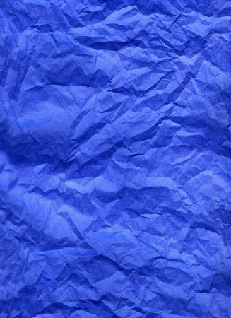 Wrinkled blue silk paper texture background.