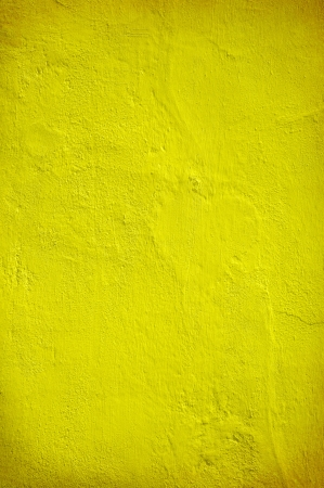 Plastered yellow green wall in closeup