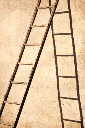Simple ladder with shadow against a wall in grunge.