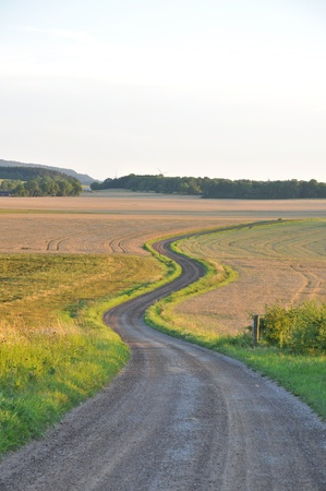 Winding road through rural landscape. photo