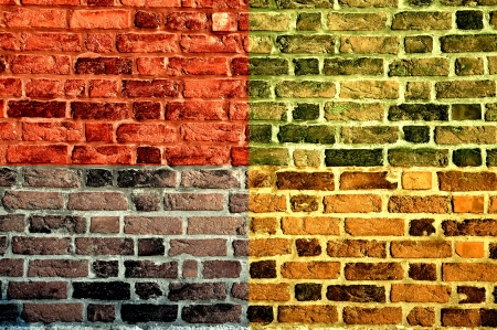 Old brick wall in four different colors. photo