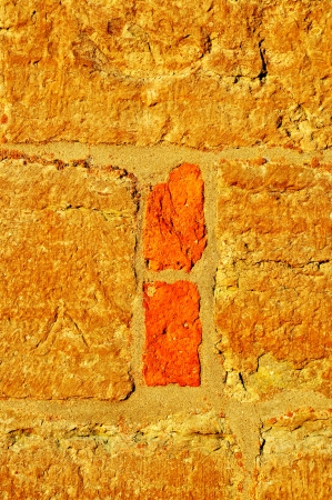 Closeup of an old wall in gold and orange. photo