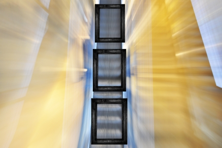 Three black frames in different sizes on blured escalator background. Stock Photo - 14773773