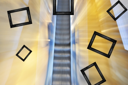 Black frames scatter from blurred escalator background. Stock Photo - 14773775