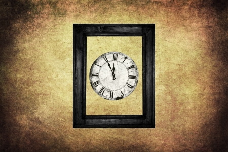 Old clock in black wooden frame on grungy wall. Stock Photo - 14841624