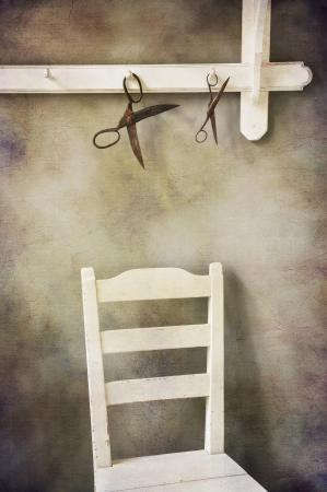 Still life scissors and shabby chic wooden chair. photo