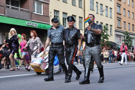 STOCKHOLM, SWEDEN - AUGUST 4: Three unidentified men in leather participates in the pride parade on August 4, 212 in Stockholm. Approximately 50,000 people march the parade and 500,000 bystanders watch.