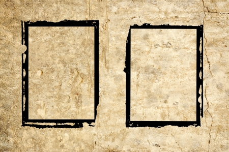 Two black grungy frames on an old rough wall. Stock Photo - 14902062