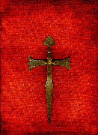 Old cross on a red background.