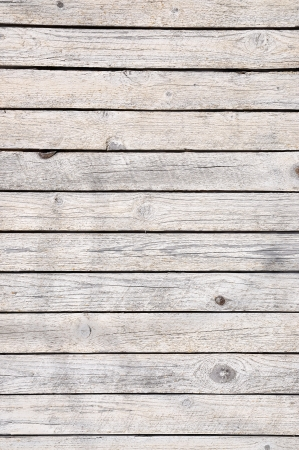 Old cracked wooden plank in gray as background  Stock Photo