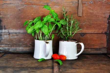 Herbs and tomatoes in rustic kitchen photo