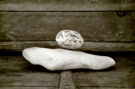 ascend: Stones in harmony on old wood