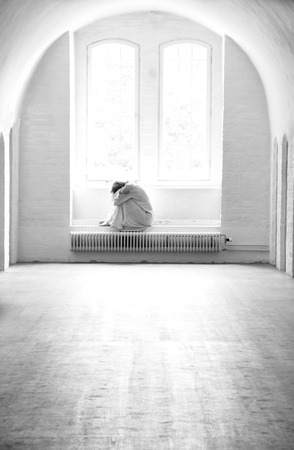 Depressed woman lonely in a mental institution