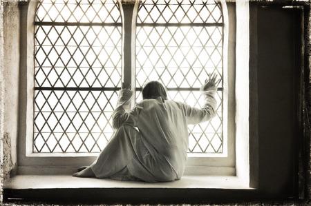 Desperate woman at a psychiatric ward, grungy style  Stok Fotoğraf