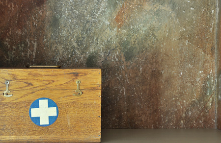Vintage first aid box vith cross.