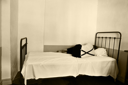 Depressed man on bed in a mental hospital