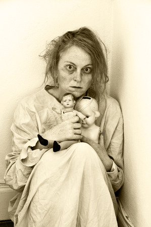 Woman in a psychiatric ward with two dolls. photo
