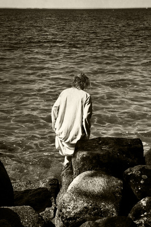 Lonely woman going into water,  photo