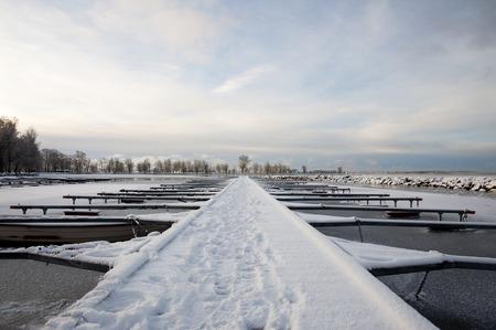Long jetty in frozen landscape. photo