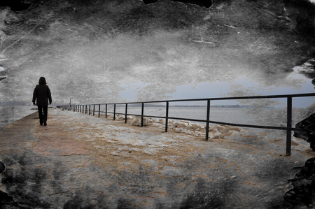 Creative grungy textured image of lonely person walking on pier.