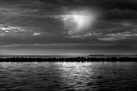 rocks water: Sunset with dramatick sky in black and white. Stock Photo