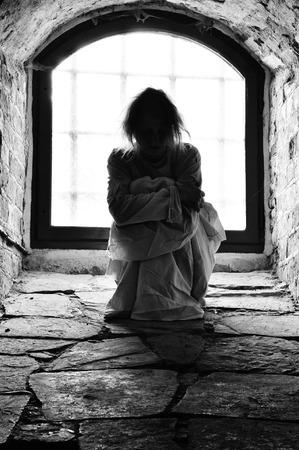 Mentally ill woman locket up in a cellar.