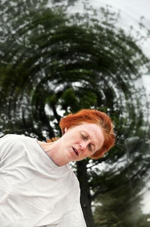 dizzy: Woman feeling dizzy, the world spinning around her.