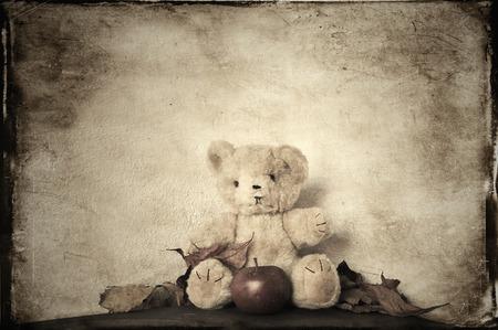 Monochromatic teddy bear vintage textured.