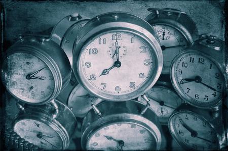 Closeup of textured image of vintage alarm clocks in blue.