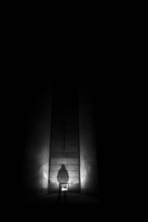 welded: Spooky shadow of a person waiting inside a silo.
