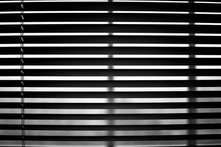 semi: Closeup of semi open blinds in black and white. Stock Photo
