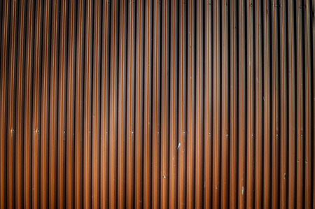 webb: Corrugated iron wall with birdshit and spider webb.